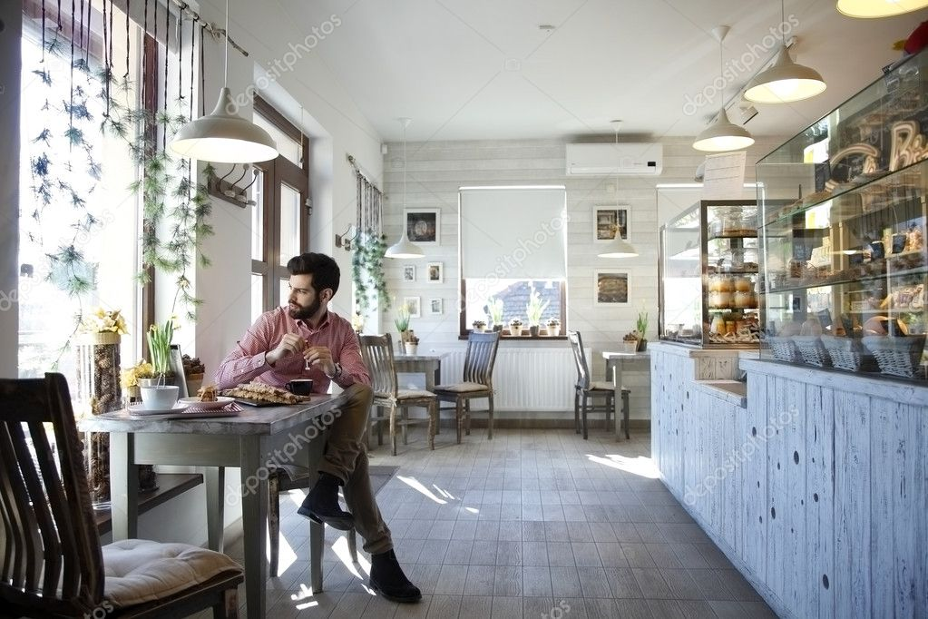 depositphotos_41260981-stock-photo-young-man-sitting-in-coffee